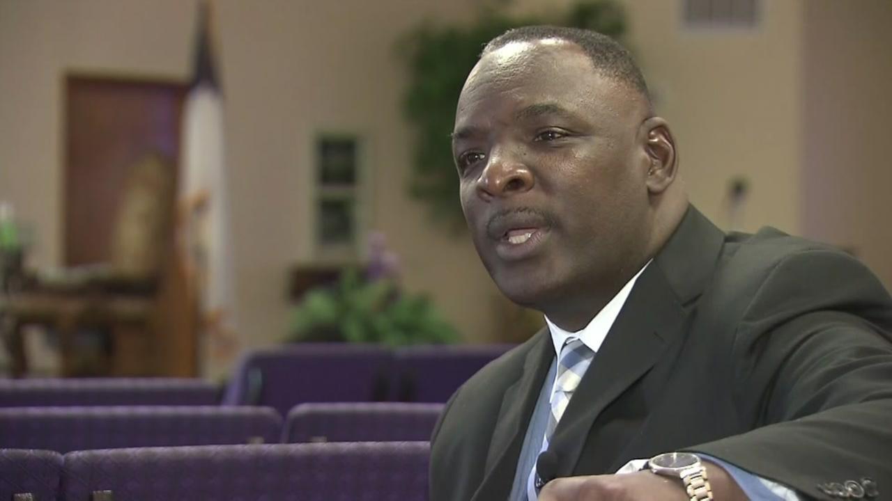 Pastor talks down man with gun