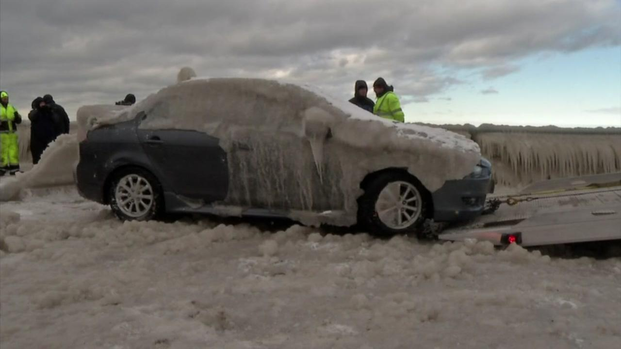 Frozen car freed from parking space