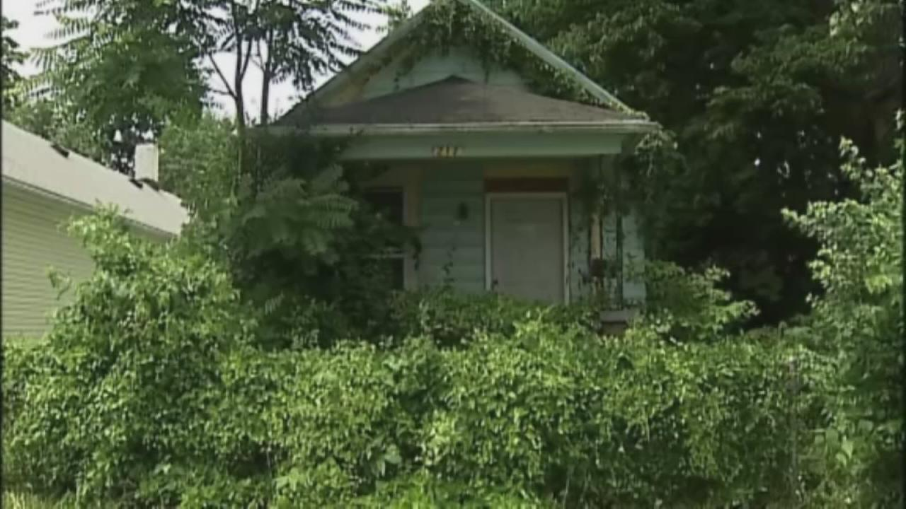 Boy finds mummified body hanging in home
