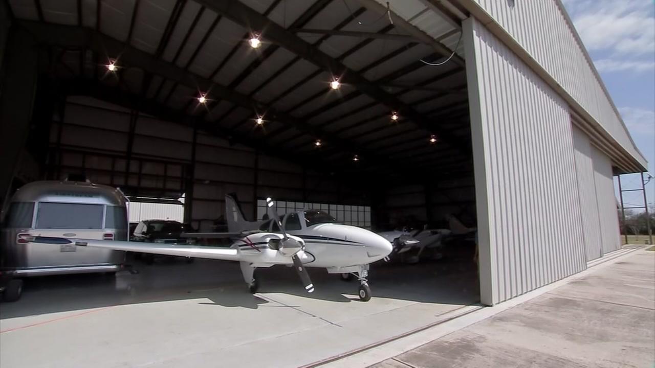 Half hangar, half home