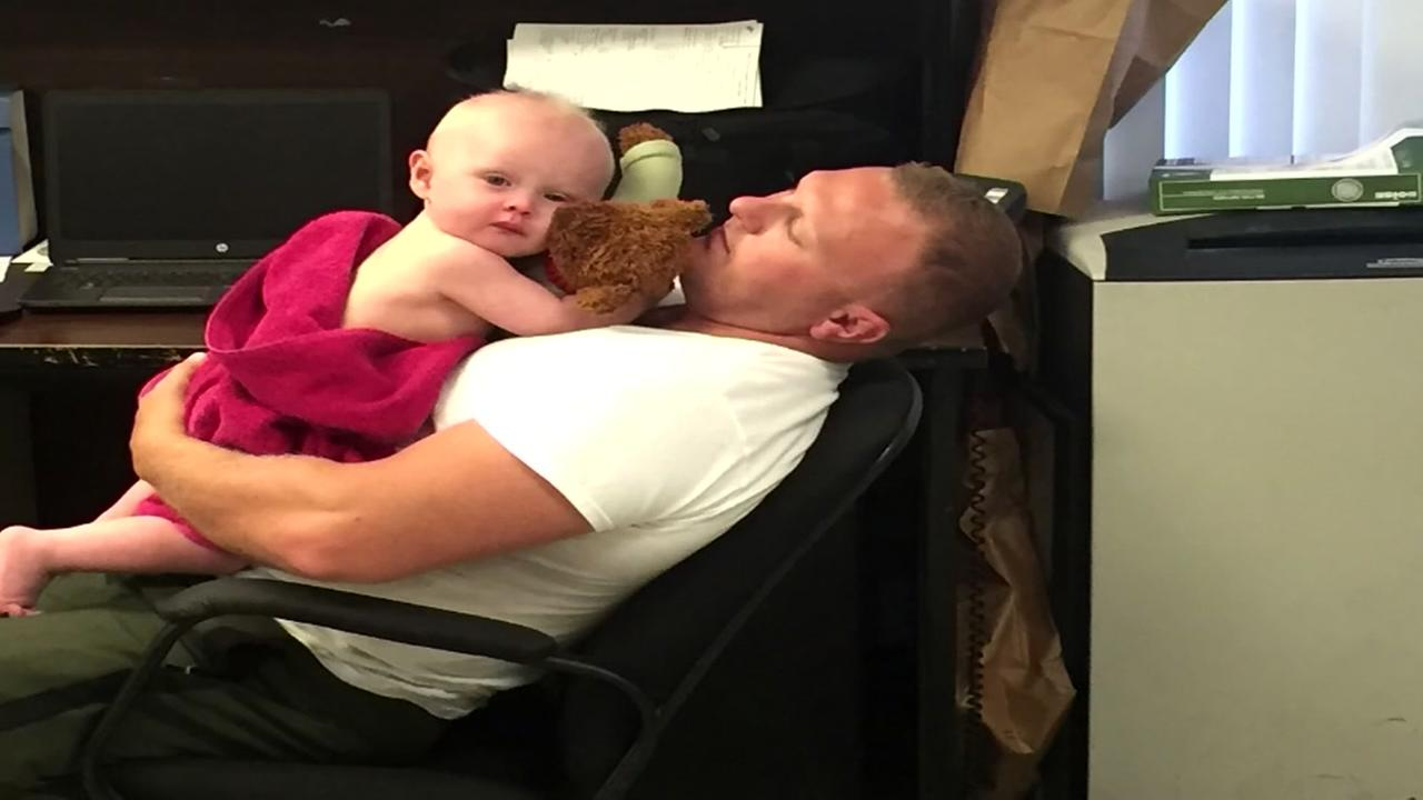 Troopers rescue baby covered in vomit