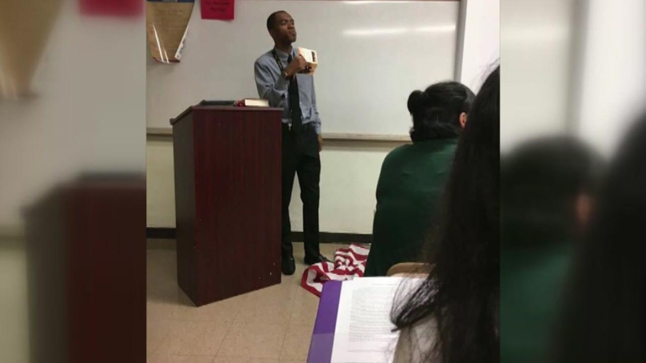 Teacher suspended for stepping on flag