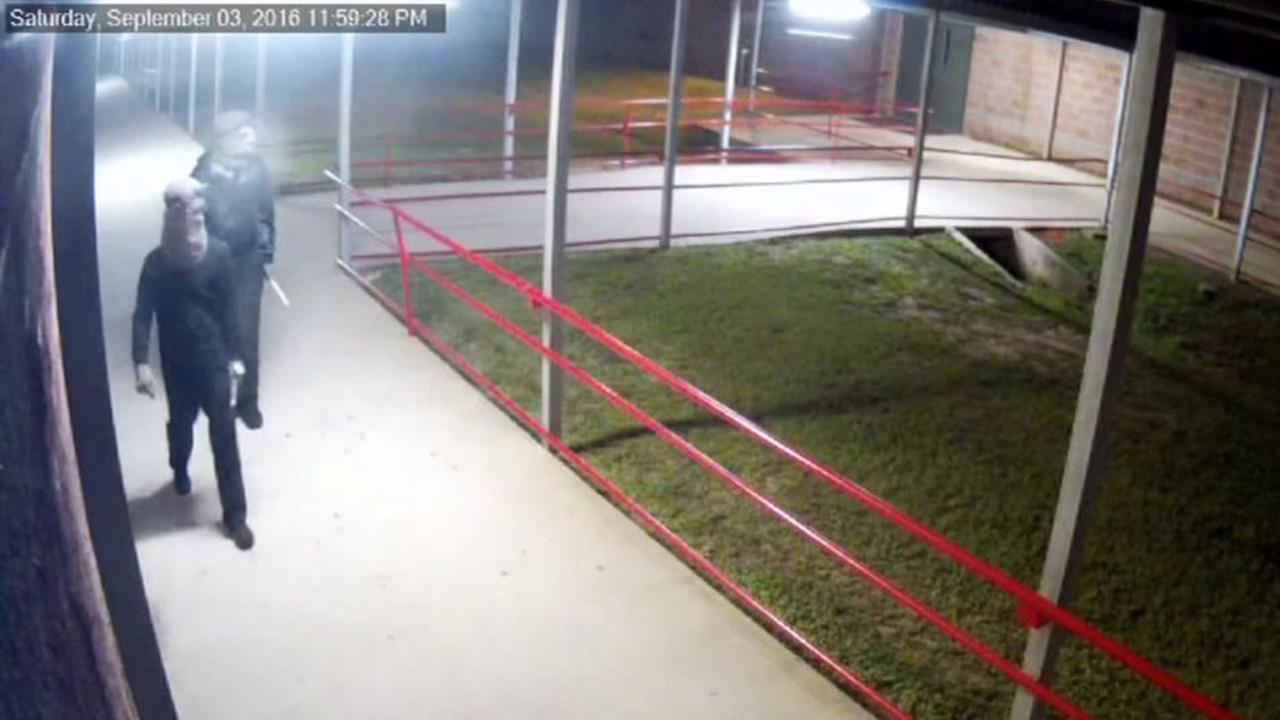 Vandals wanted after trashing schools