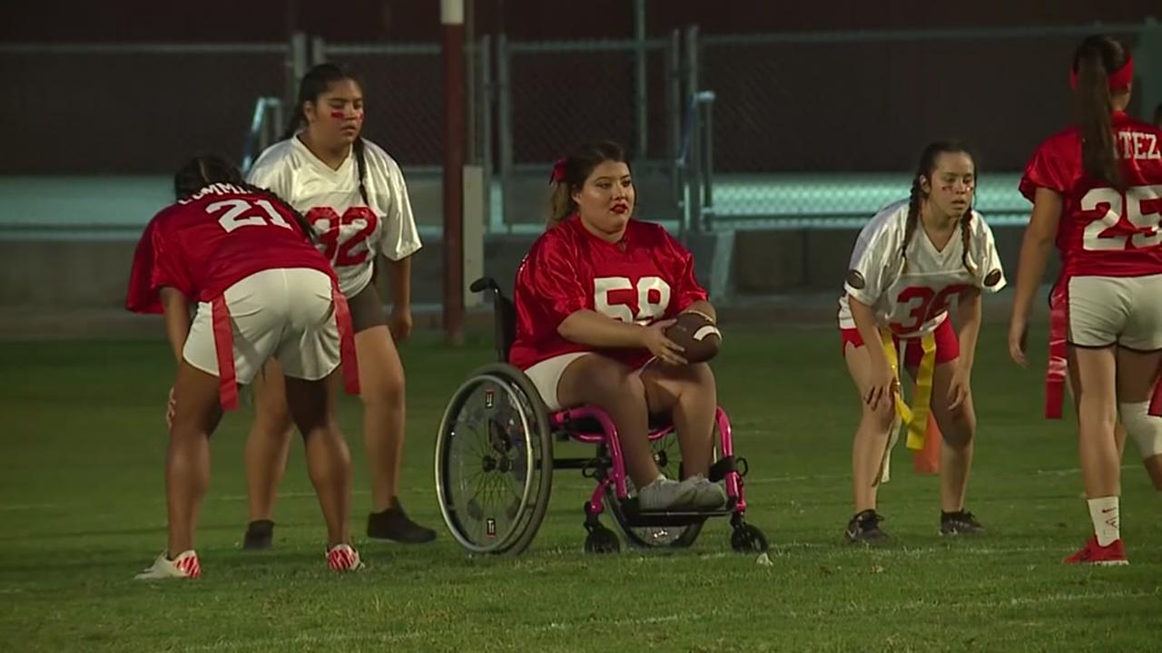 Wheelchair-bound student plays football