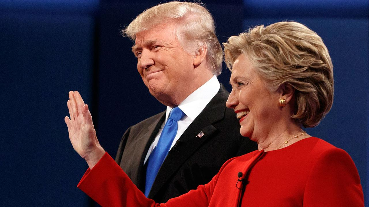 Republican presidential candidate Donald Trump, left, stands with Democratic presidential candidate Hillary Clinton at the first presidential debate at Hofstra University.