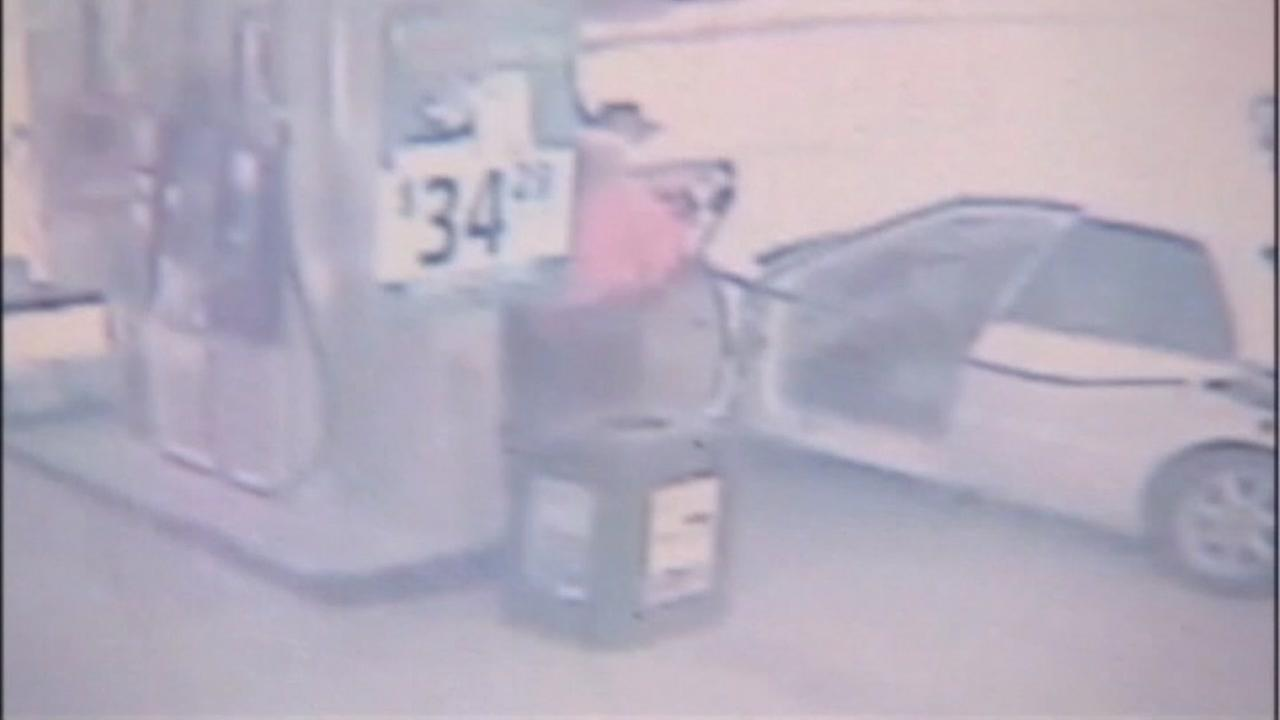 Woman run over by truck while pumping gas