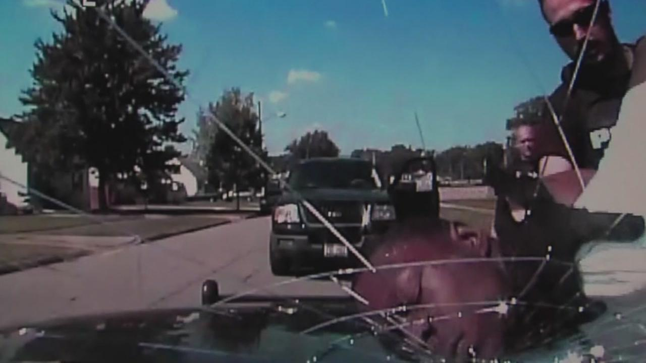 Officers crack windshield with suspects head