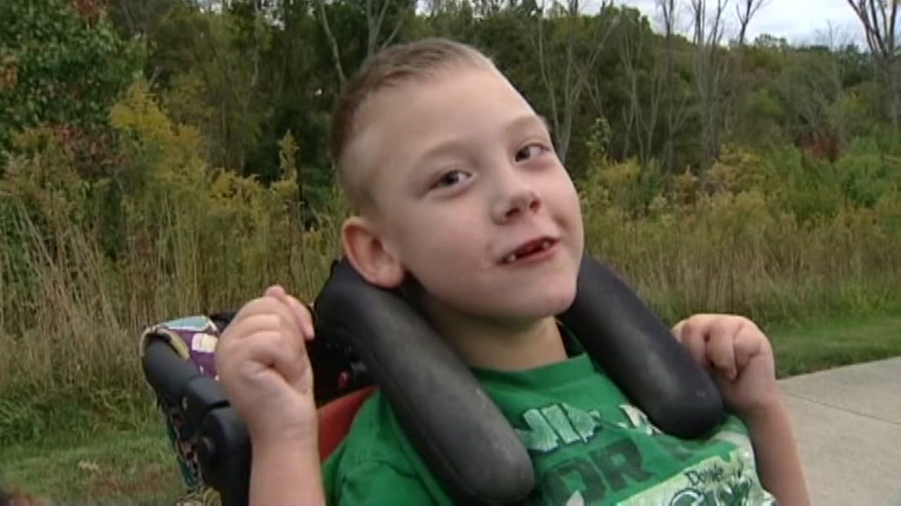Boy battling brain disorder scores touchdown
