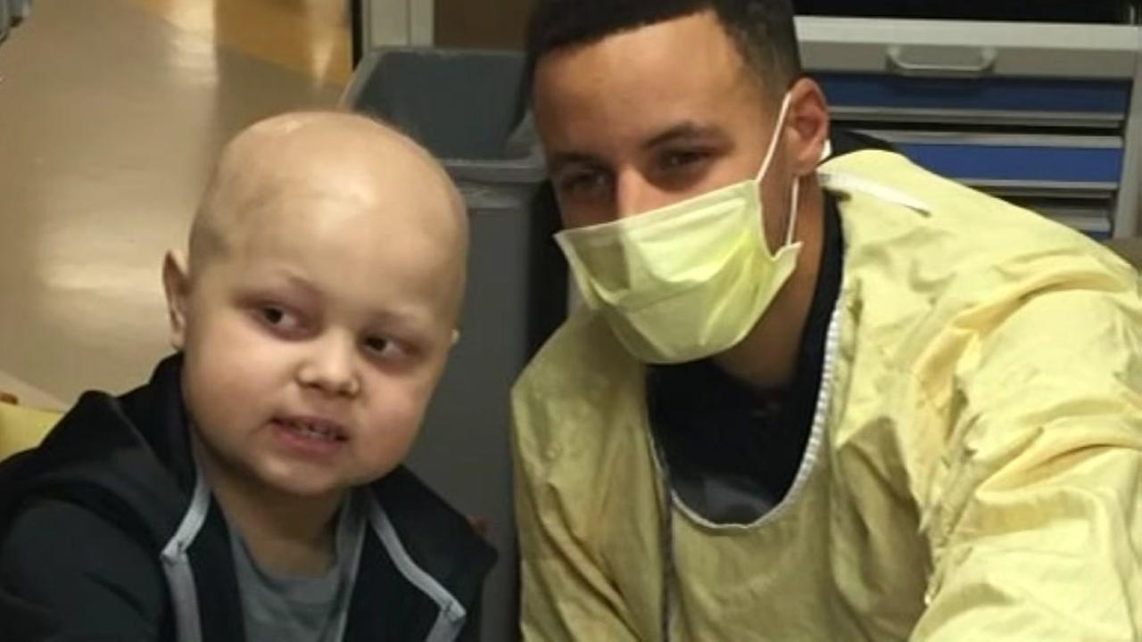 Steph Curry visits child with cancer