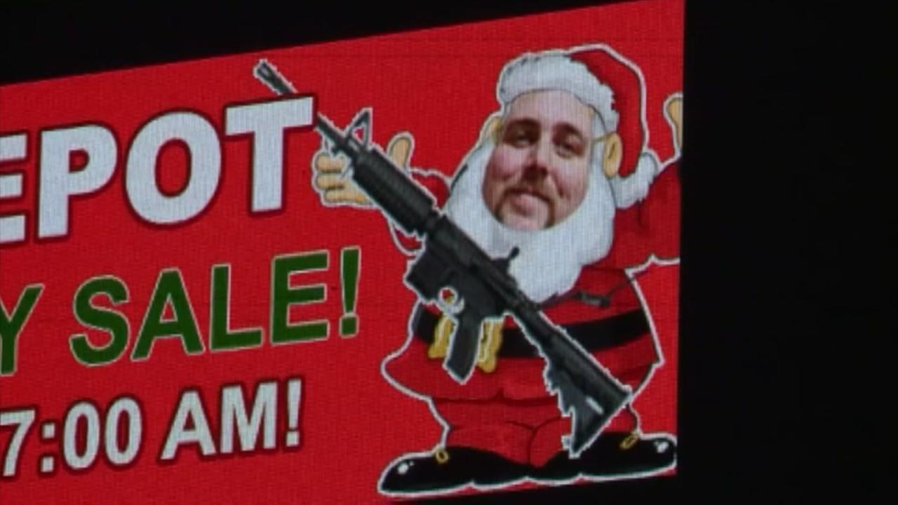 Billboard with armed Sanata raises eyebrows