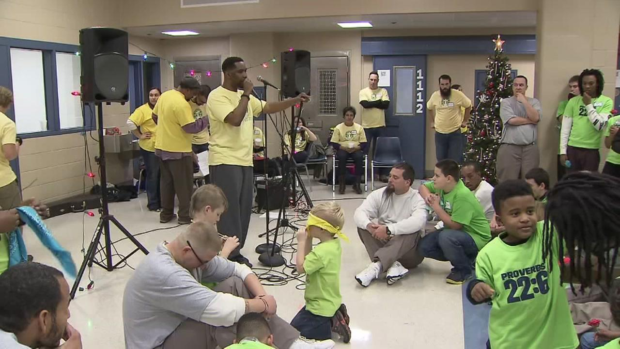 Incarcerated fathers spend time with children for holidays