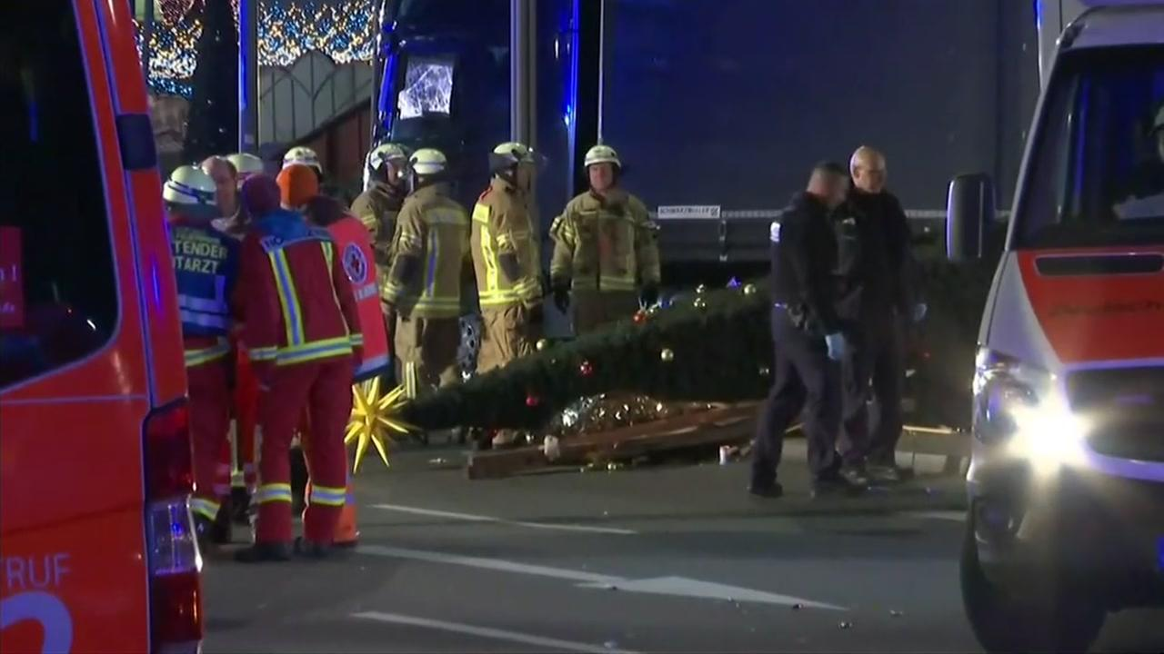 Emergency crews work to investigate after a truck drove into a crowded Christmas market in Berlin.