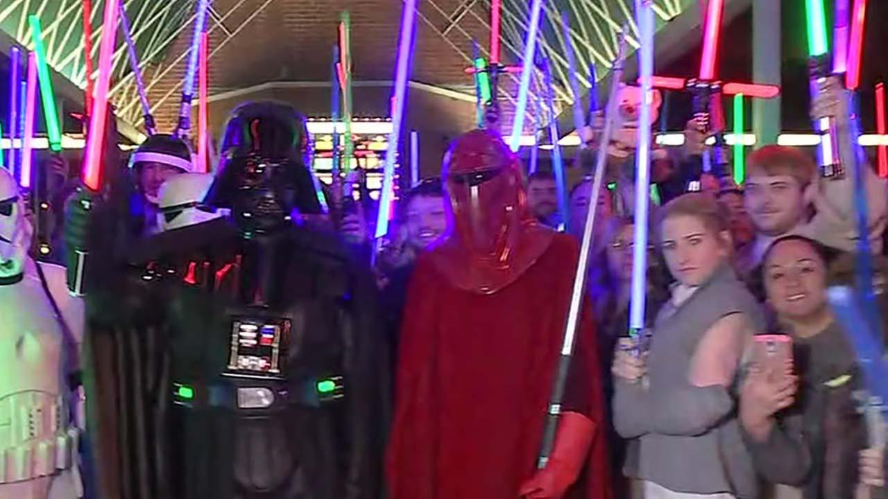 Fans hold lightsaber vigil for Carrie Fisher in Katy
