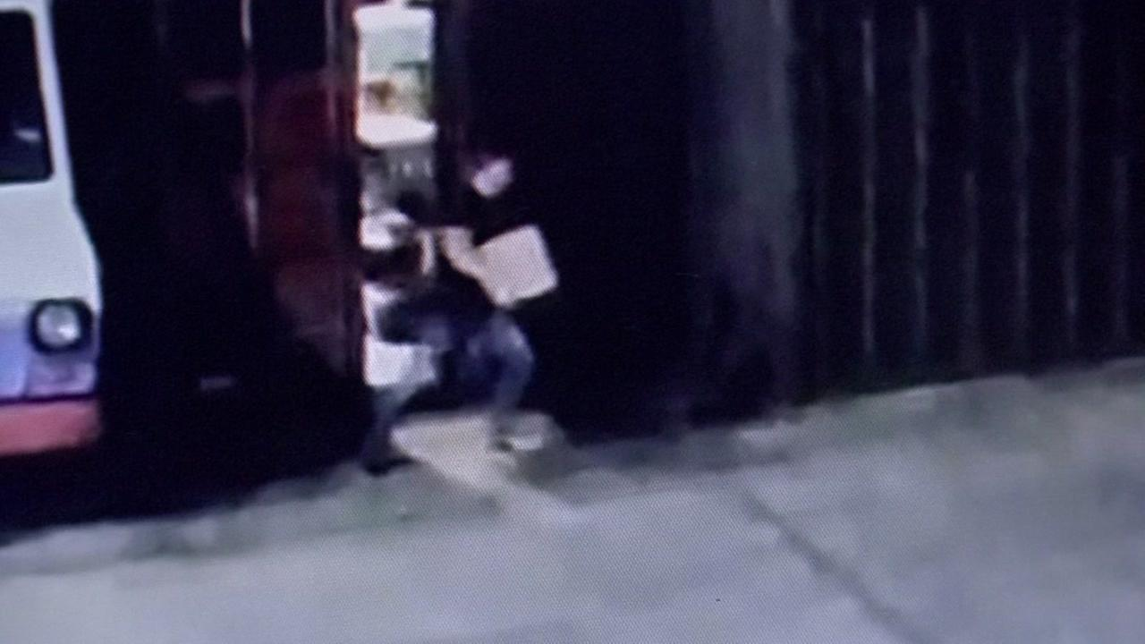 Man caught on camera clearing out bars liquor supply