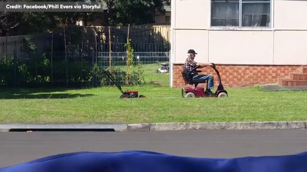 Austrailian man uses mobility scooter to mow lawn