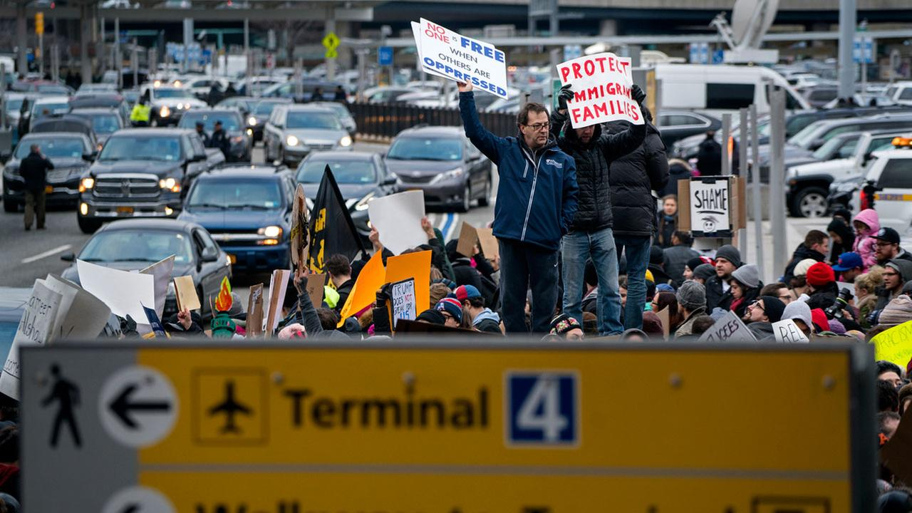 Protesters assemble at John F. Kennedy International Airport in New York, Saturday, Jan. 28, 2017 after two Iraqi refugees were detained while trying to enter the country. AP Photo/Craig Ruttle