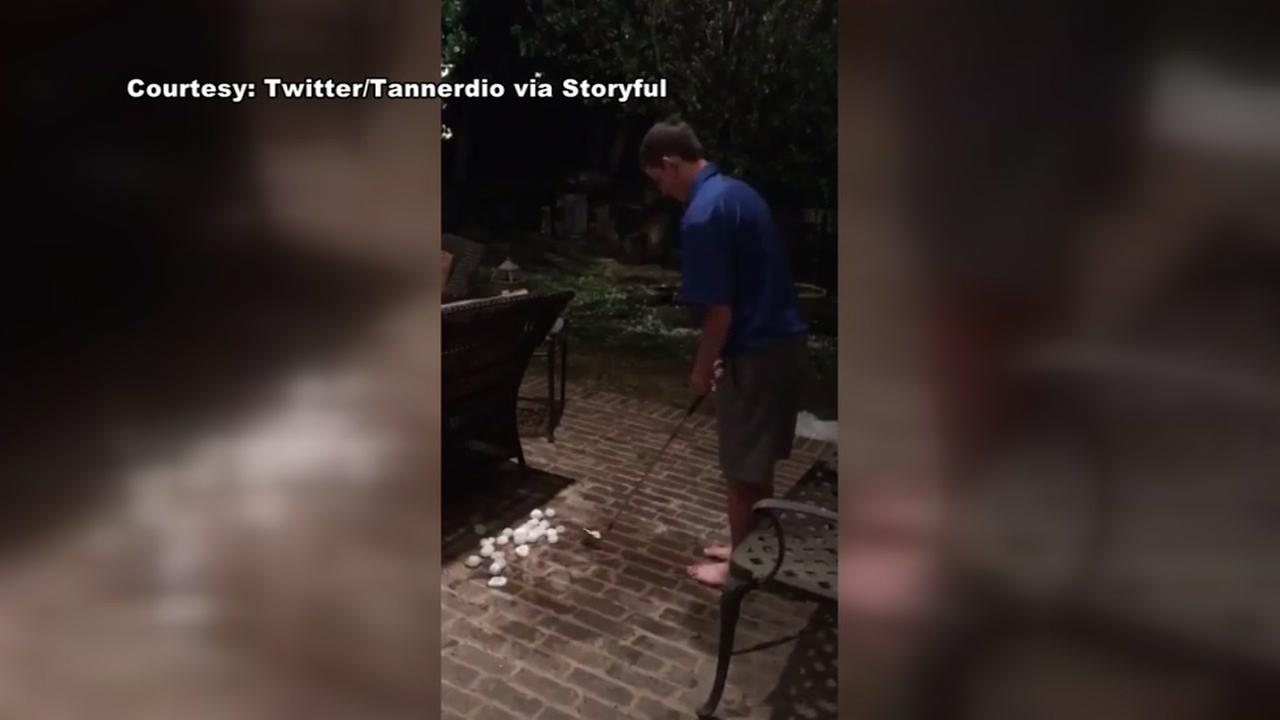 Boy practices golf skills with balls of hail