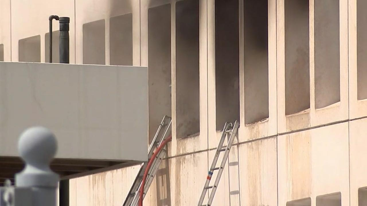 Firefighters putting out 3-alarm highrise fire downtown