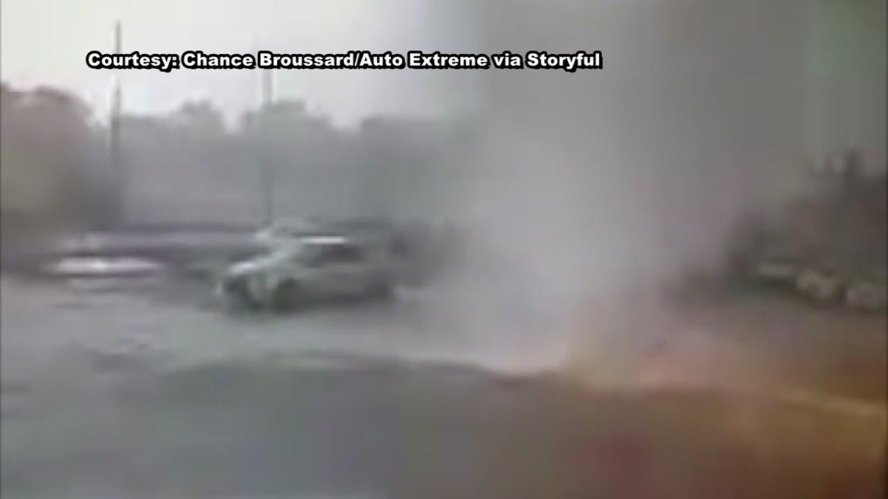Tornado flips car at Louisiana repair shop