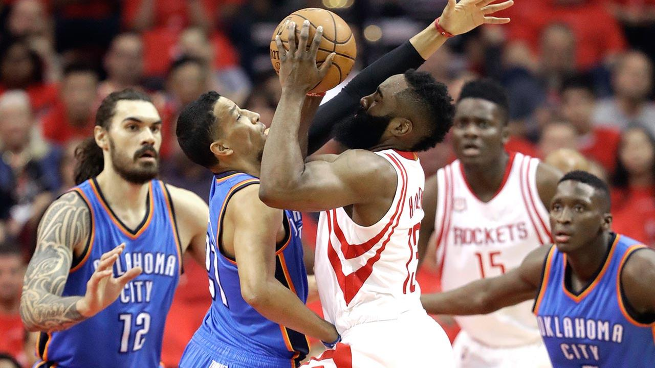 Houston Rockets James Harden (13) drives toward the basket as Oklahoma City Thunders Andre Roberson