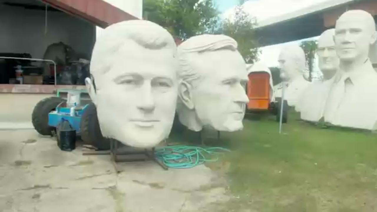 Nearly 20-foot tall carvings of presidential faces sit on a Nance Street lot. Look around and youll see