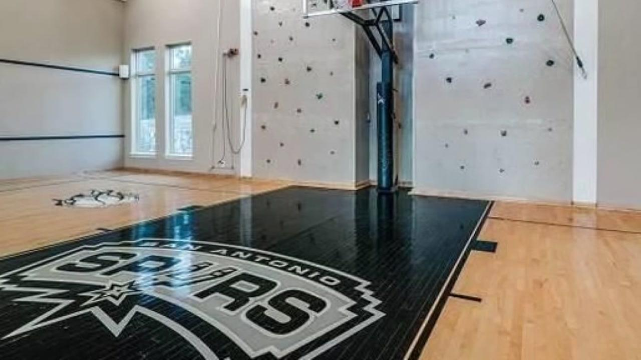 Beautiful meditteranean estate in the Hill Country comes with basketball court