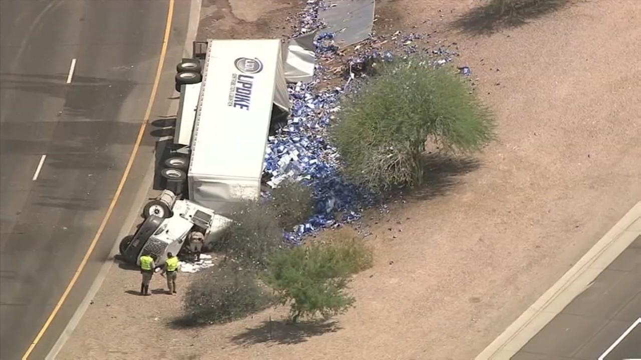 Overturned truck spills thousands of Bud Light cans
