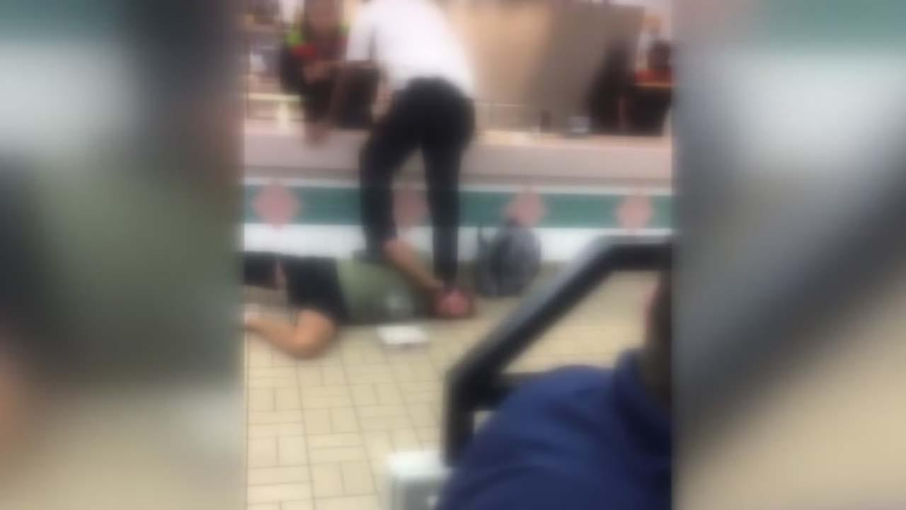 Eyewitness video shows punches thown at Burger King