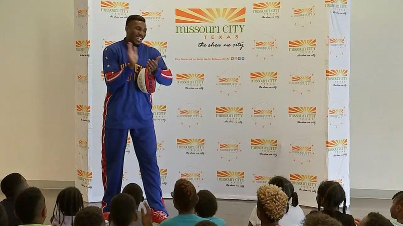 Summer camp children get a visit from a Harlem Globetrotter
