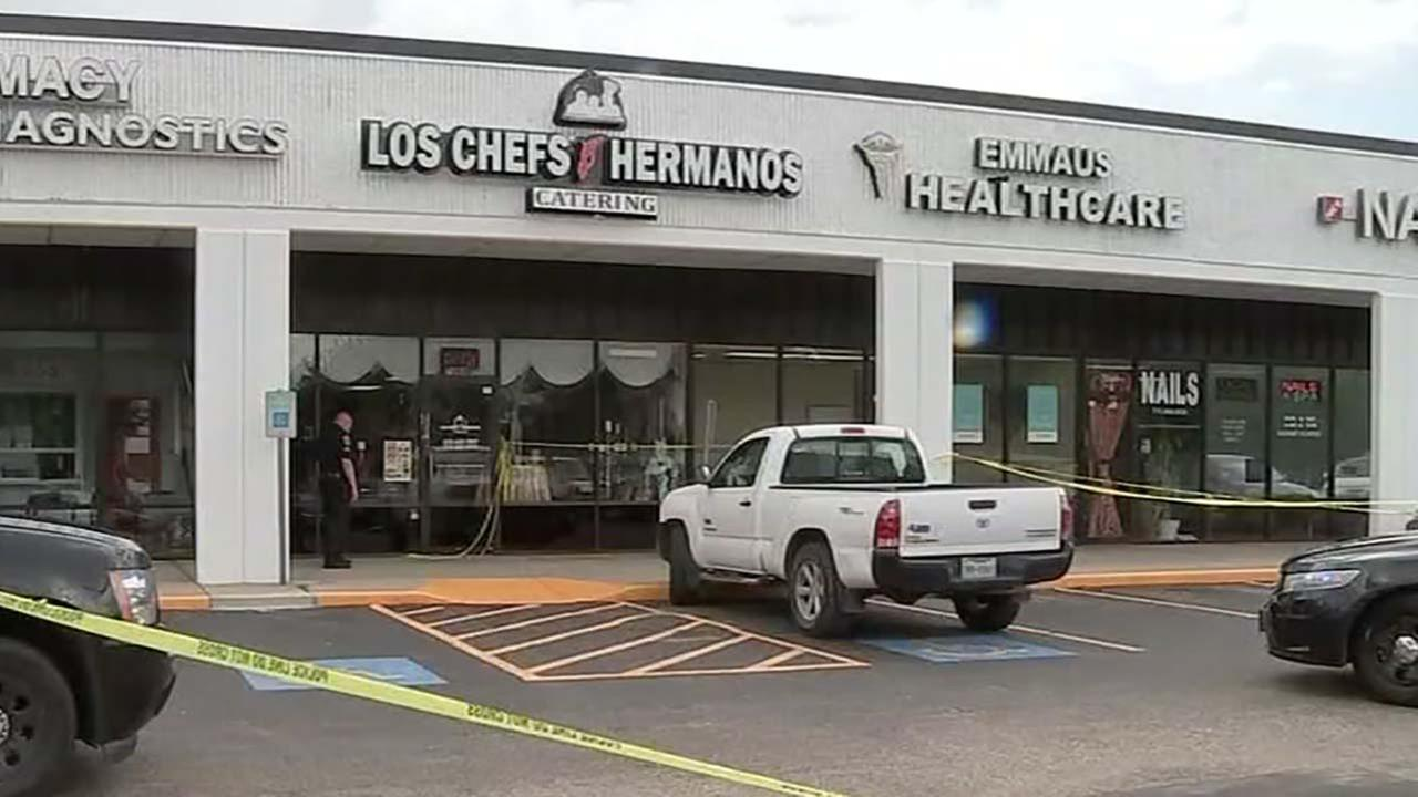 Owner of catering business shot while walking into work