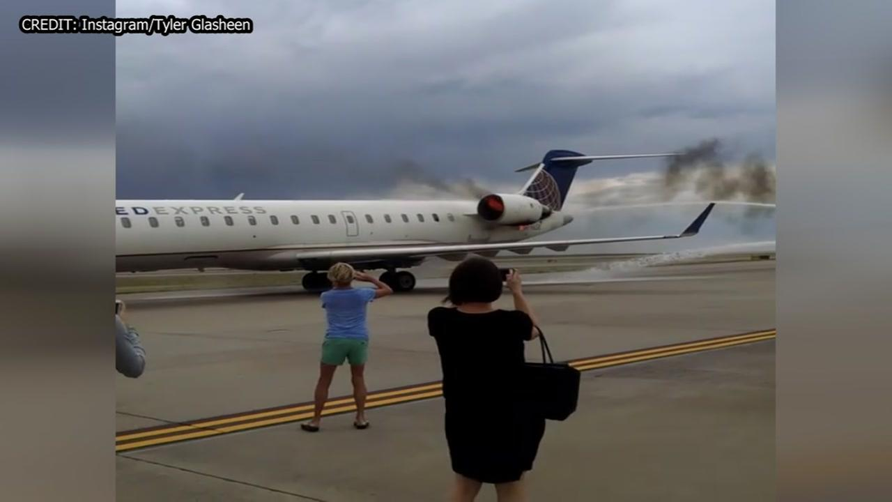 Engine catches fire after United plane lands in Denver