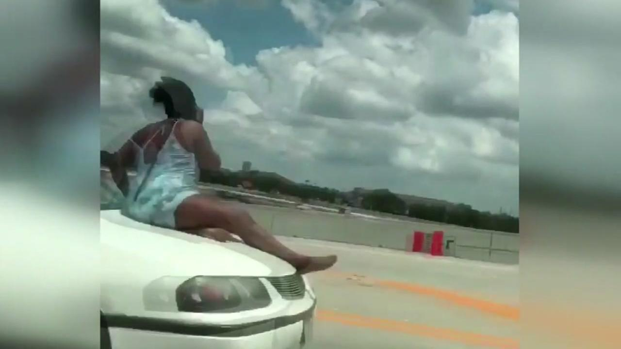 911 call made by woman who was riding on hood of car