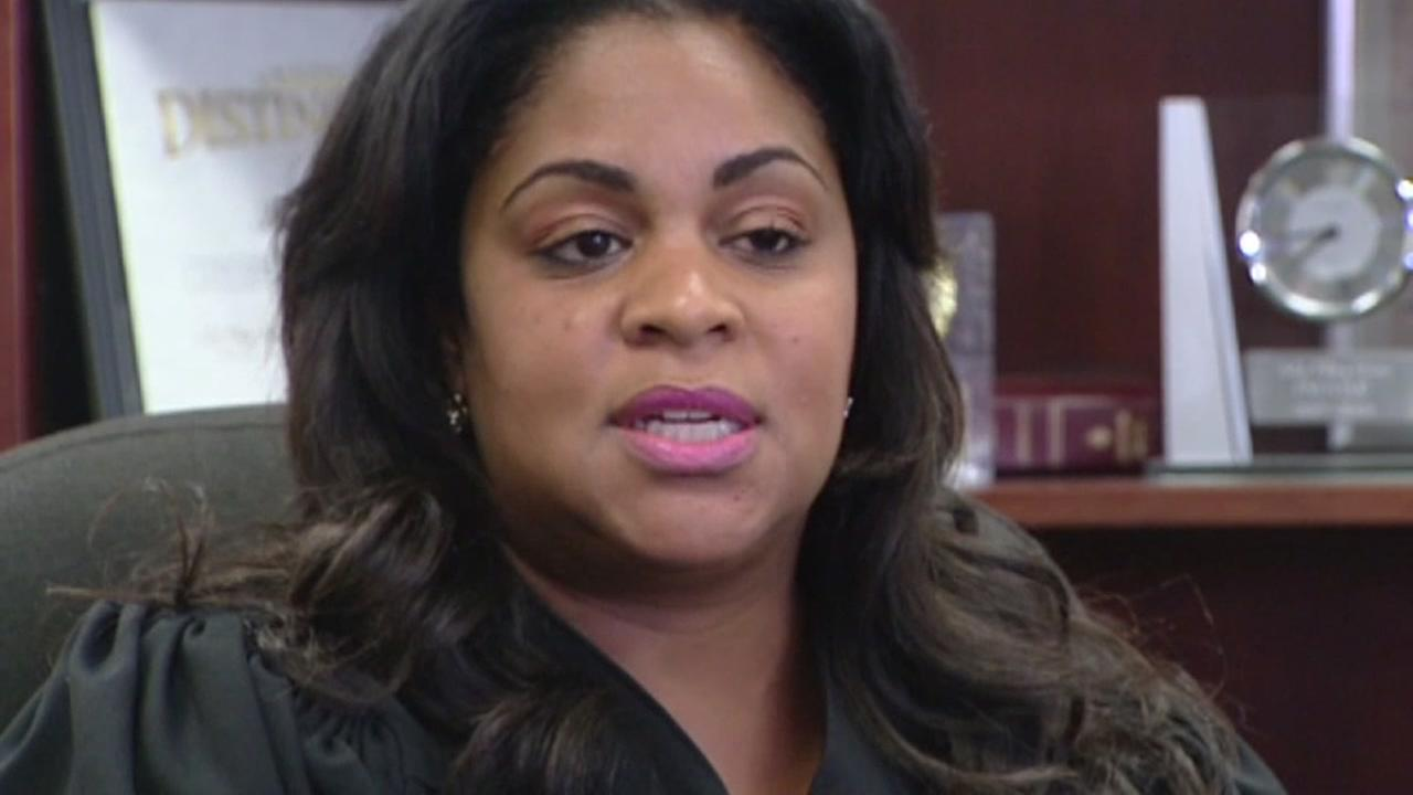 Embattled judge suspended without pay