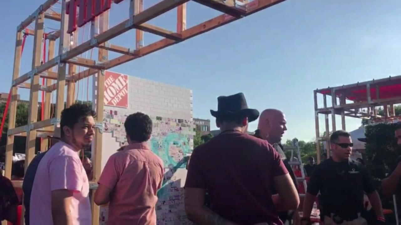 Anti-Trump protesters try knocking down Home Depot-sponsored wall at Ruido Fest