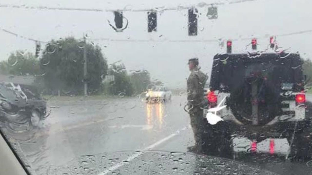 Why is this soldier standing at attention in the rain?