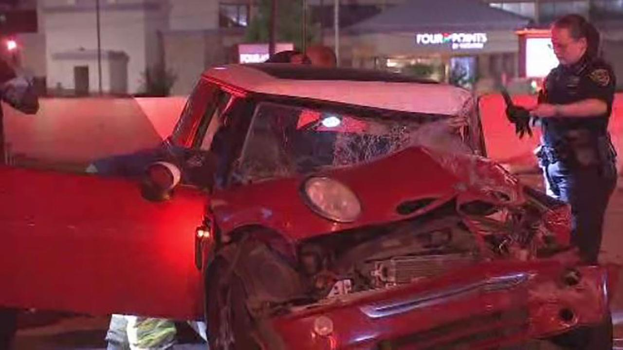 Street sweeper hit, driver trapped after Southwest Fwy crash