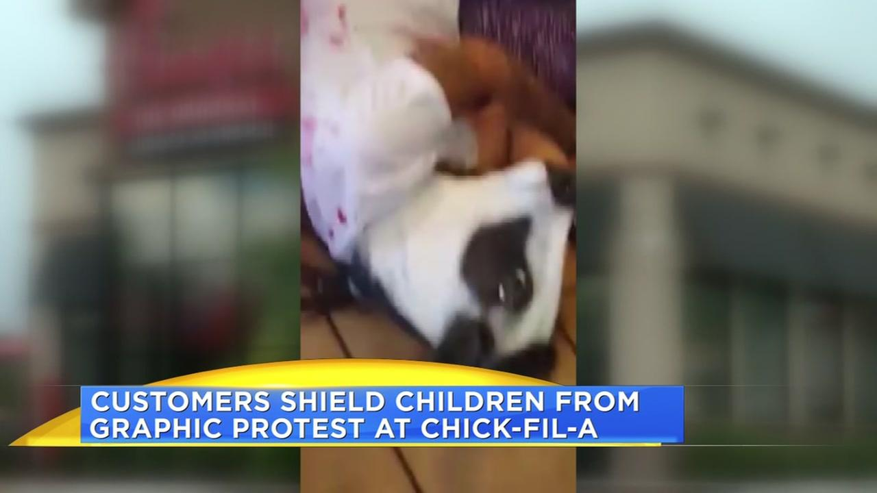 Customers shield children from graphic protest at Chick-fil-A