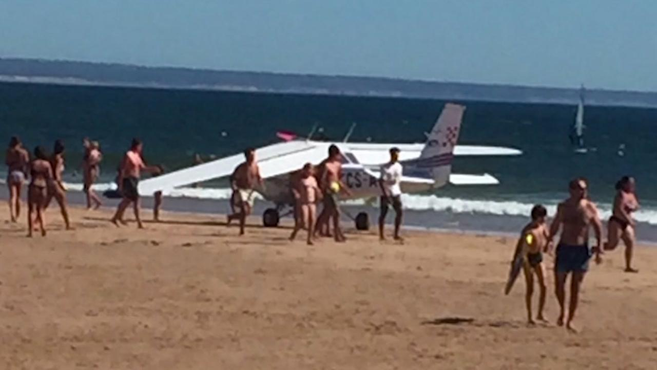 Plane crashes into packed beach, kills child and man