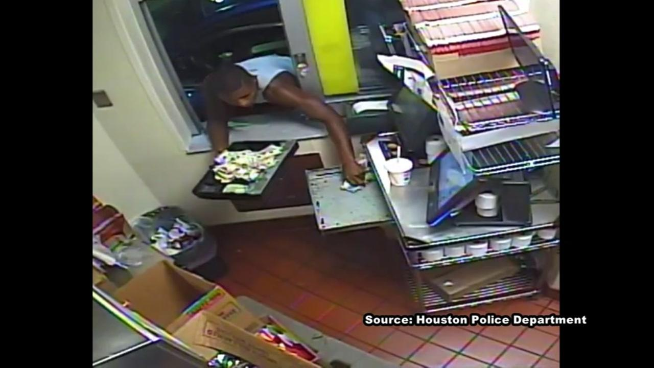 Robber who forced himself through drive through window is on the run