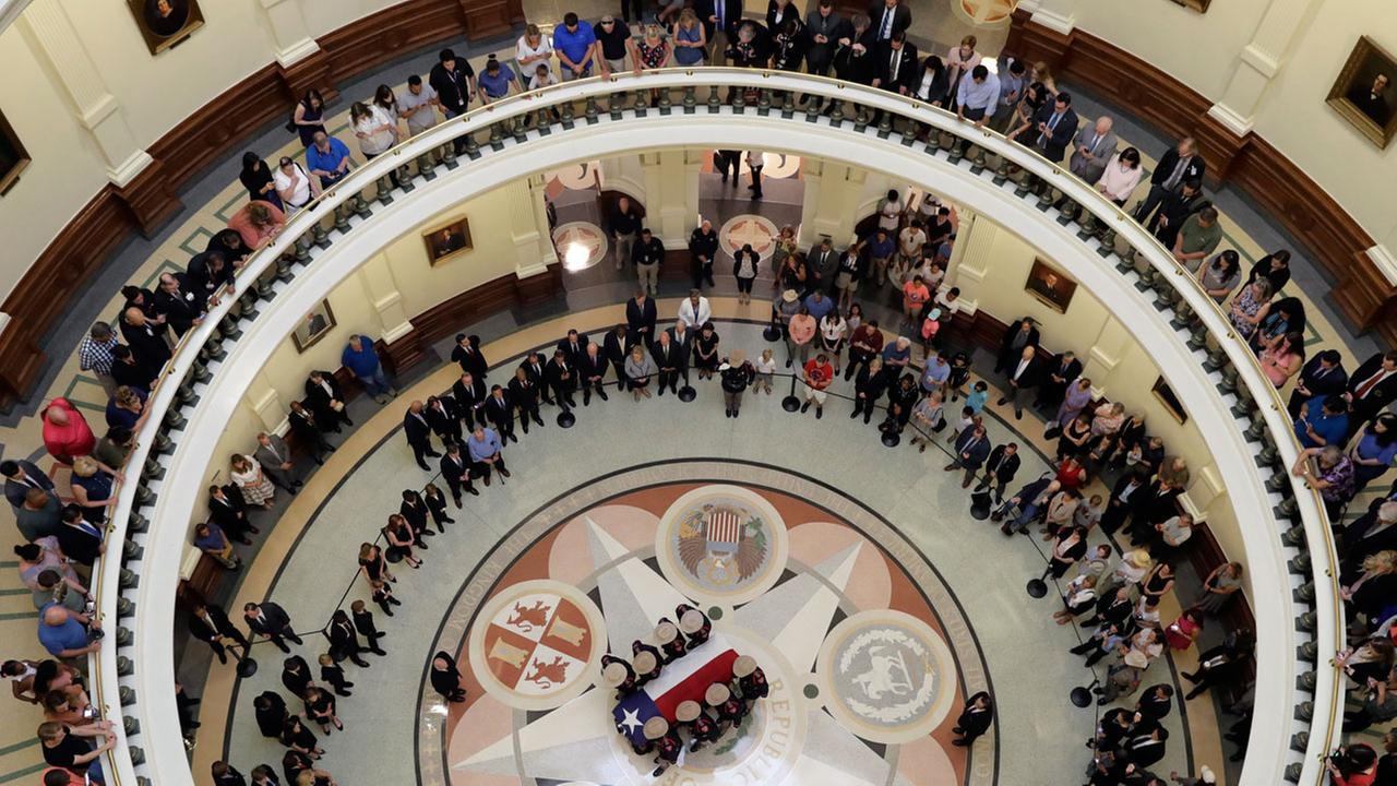 Honor guard moves the casket of former Texas Governor Mark White to the Rotunda at the Texas Capitol, Thursday, Aug. 10, 2017, in Austin, Texas.