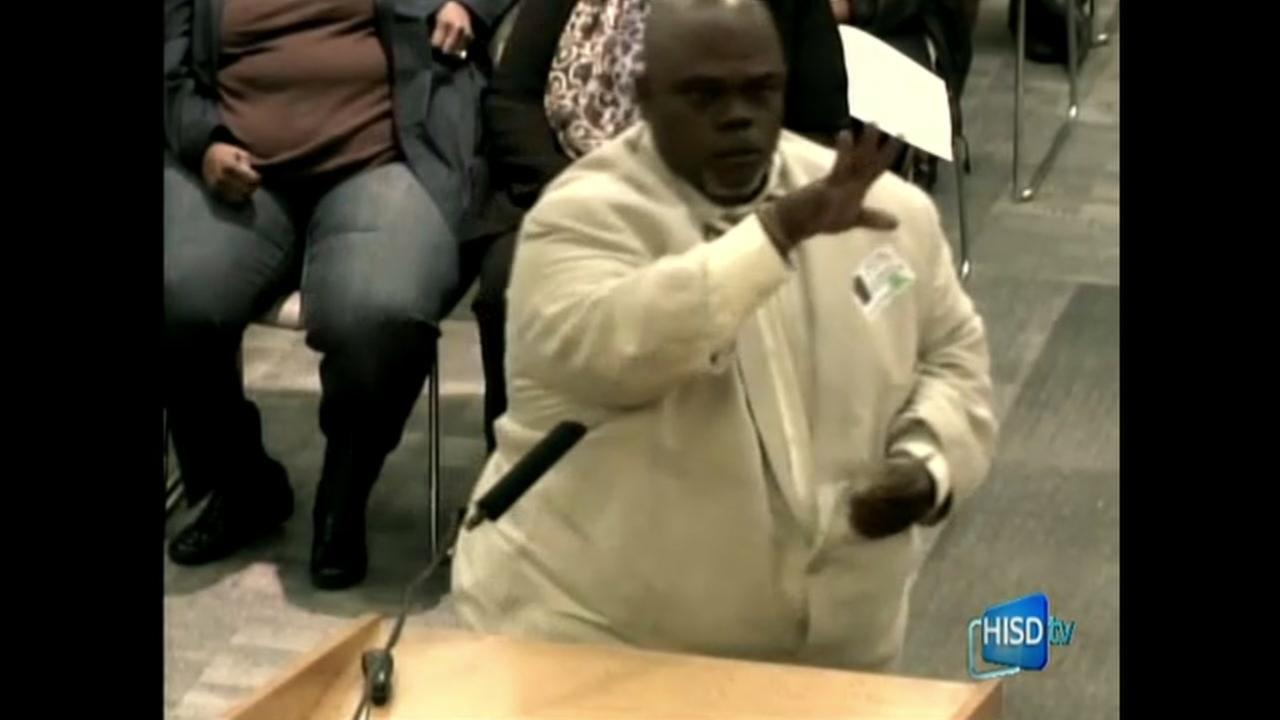 Community activist throws money during HISD meeting
