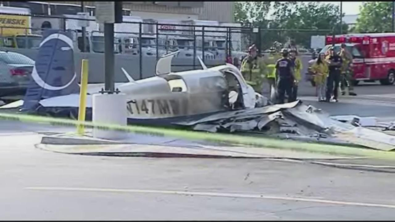 One dead after plane crashes in parking lot