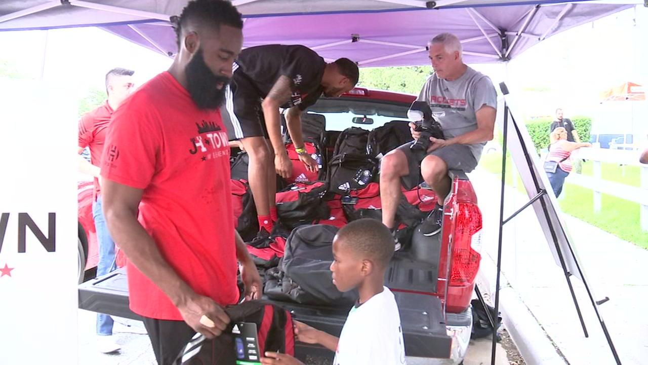 James Harden gives out school supplies to kids in Houston