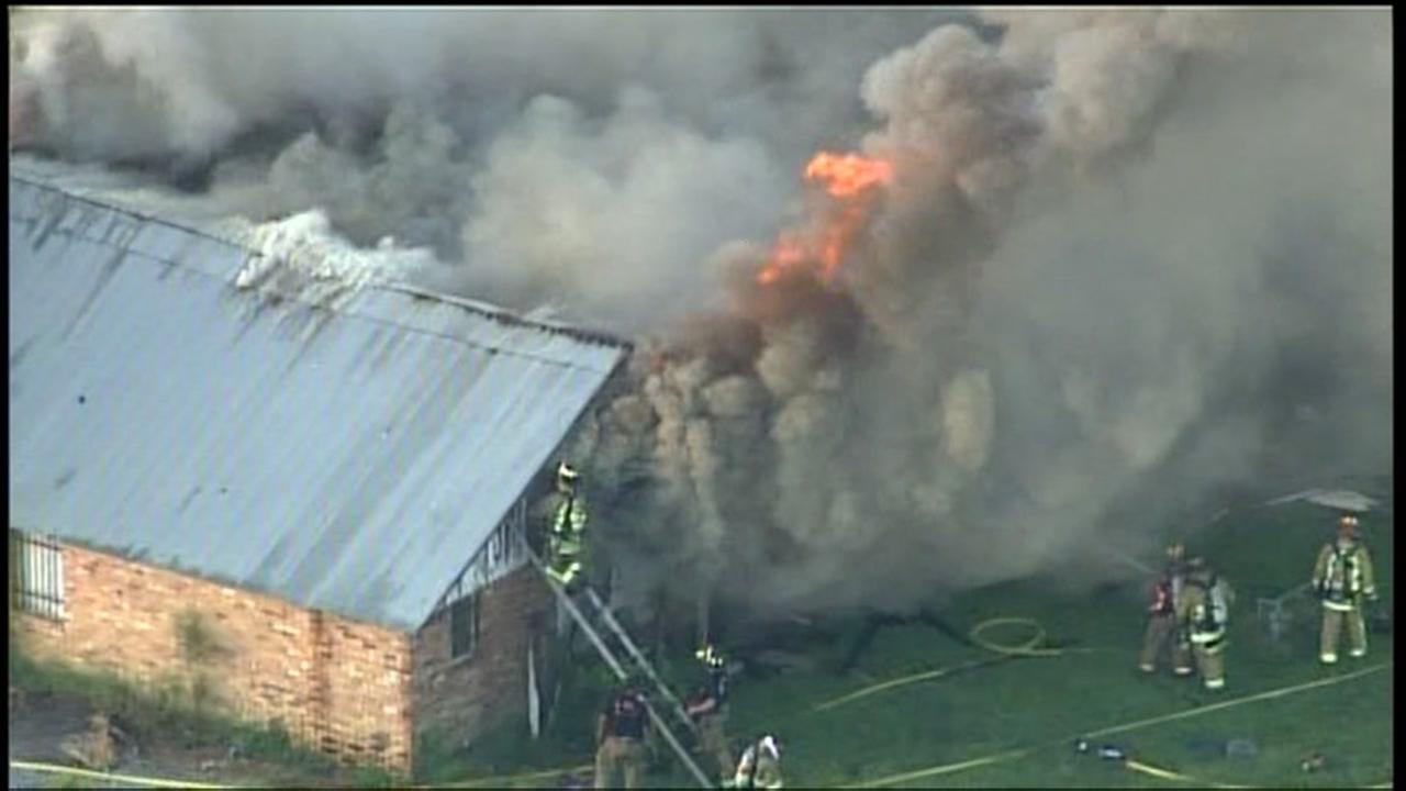 Firefighters battling building fire in Crosby