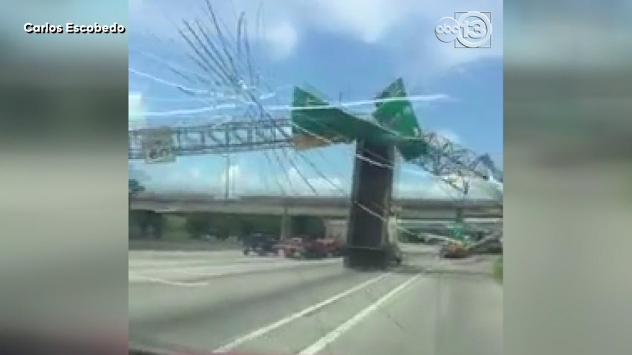 Truck slams into overhead sign