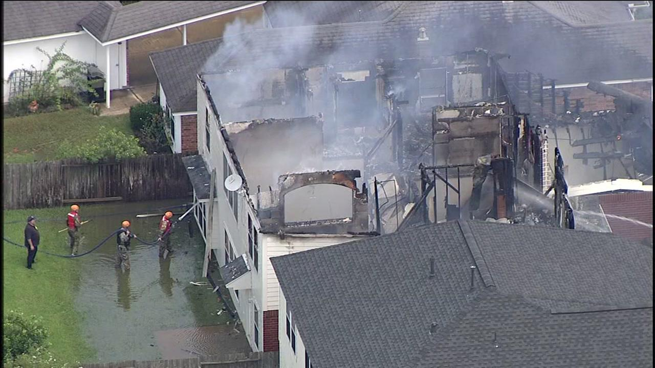 Firefighters battle fire at flooded home in Katy area
