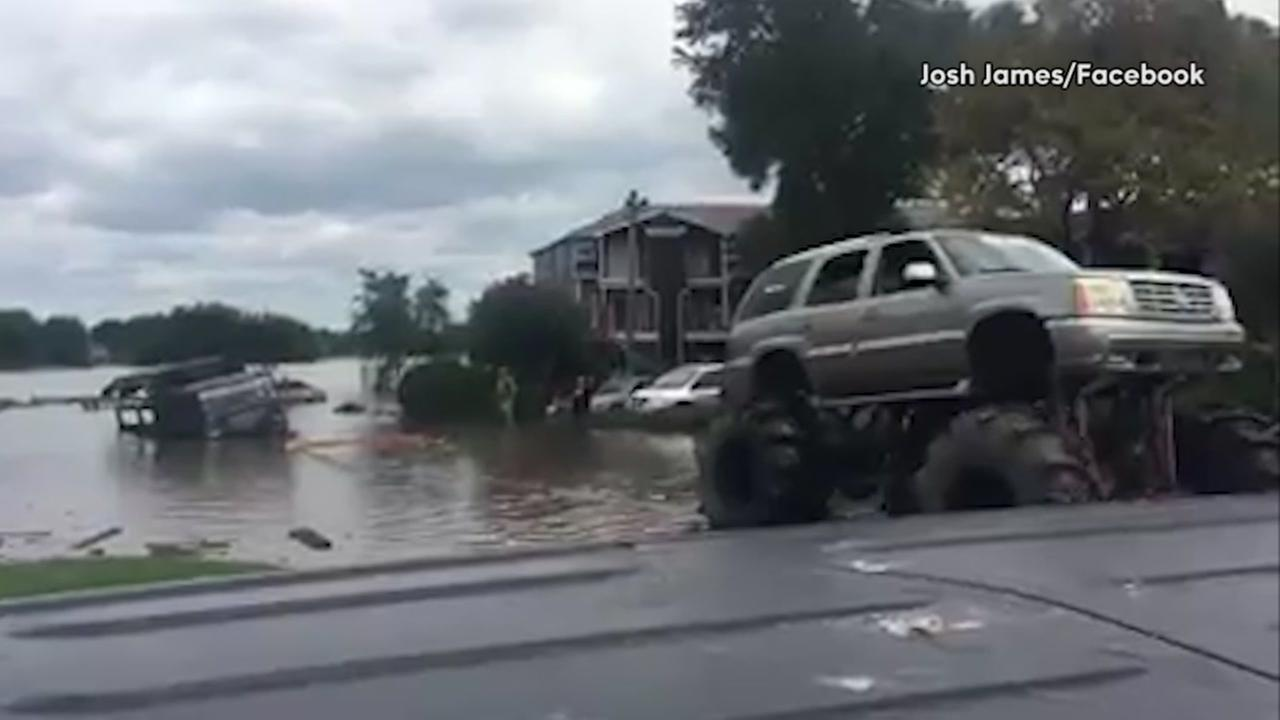 Monster trucks help pull vehicles out of water