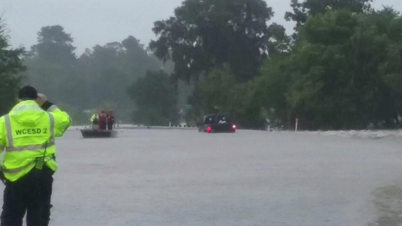 Floodwaters pull baby from mothers arms in New Waverly