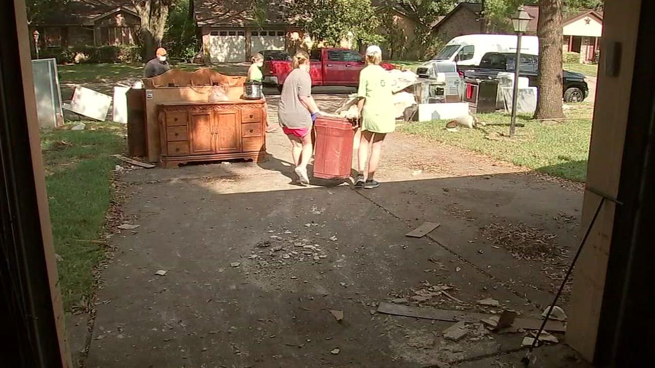Harris Co. prosecutors clean up flooded home