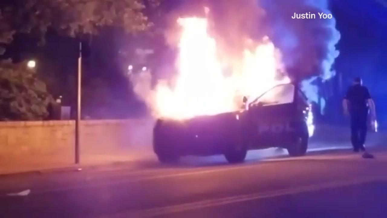 Police car set on fire during protests in GA Tech